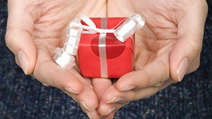 Woman holding miniature gift